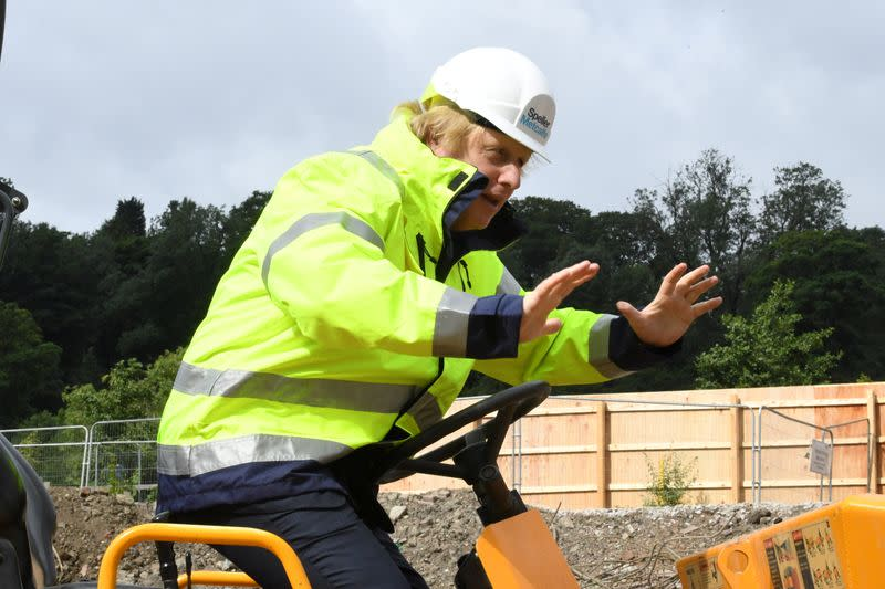 Britain's Prime Minister Boris Johnson gestures visits the Speller Metcalfe's building site in Dudley