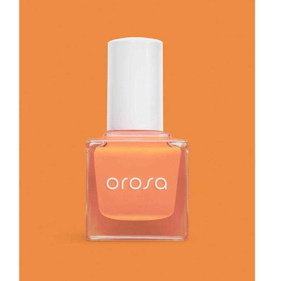 """I've been whipping out Orosa's """"Super Bloom"""" nail polish for some Southern California vibes. It's a muted apricot that reminds me of the blankets of poppies that cover the <a href=""""https://www.visitcalifornia.com/experience/antelope-valley-california-poppy-reserve"""" rel=""""nofollow noopener"""" target=""""_blank"""" data-ylk=""""slk:Antelope Valley"""" class=""""link rapid-noclick-resp"""">Antelope Valley</a> when there's a (you guessed it) superbloom. The best part is that the formula is quick-cure, which seriously cuts down on wait time when doing nail art at home. <em>—S.S.</em> $12, Orosa. <a href=""""https://orosabeauty.com/collections/singles/products/super-bloom"""" rel=""""nofollow noopener"""" target=""""_blank"""" data-ylk=""""slk:Get it now!"""" class=""""link rapid-noclick-resp"""">Get it now!</a>"""