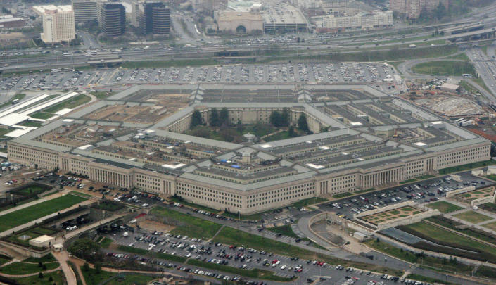 FILE - This March 27, 2008 file photo shows the Pentagon in Washington. The civilian official overseeing the Pentagon's campaign to defeat the Islamic State group in the Middle East has resigned in the latest jolt to Pentagon leadership in the waning weeks of the Trump administration.(AP Photo/Charles Dharapak, File)