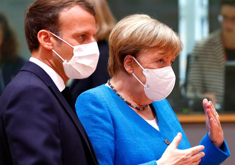 German Chancellor Angela Merkel and France's President Emmanuel Macron take part in the first face-to-face EU summit since the coronavirus disease (COVID-19) outbreak, in Brussels, Belgium July 18, 2020. REUTERS/Francois Lenoir/Pool