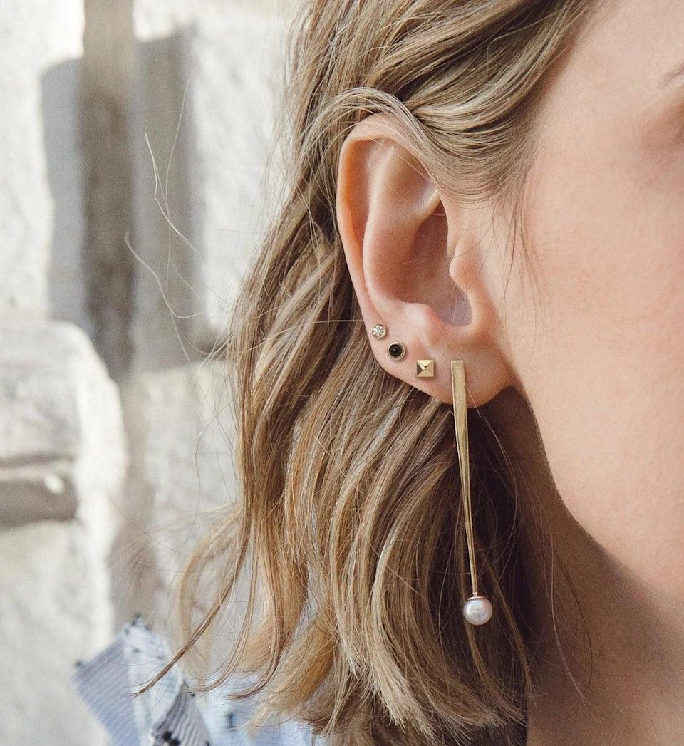 """<h3>AURate Mini Pyramid Studs<br></h3> <br>We're not mad at a pair of delicate 14K gold pyramid studs for $100 — as you can see, they'll play nice with the rest of your ear candy.<br><br><em>Shop <strong><a href=""""https://auratenewyork.com/"""" rel=""""nofollow noopener"""" target=""""_blank"""" data-ylk=""""slk:AURate"""" class=""""link rapid-noclick-resp"""">AURate</a></strong></em><br><br><strong>Aurate</strong> Mini Pyramid Studs, $, available at <a href=""""https://go.skimresources.com/?id=30283X879131&url=https%3A%2F%2Fauratenewyork.com%2Fproducts%2Fmini-pyramid-studs"""" rel=""""nofollow noopener"""" target=""""_blank"""" data-ylk=""""slk:Aurate"""" class=""""link rapid-noclick-resp"""">Aurate</a><br><br><br>"""