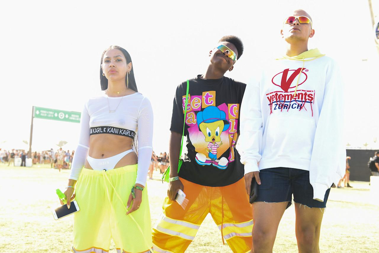 <p>This stylish group seemingly got their sartorial inspiration from Calvin Klein and Fenty Puma based on their brightly-colored palate, logo tees, and sporty sunglasses. (Photo by Presley Ann/Getty Images for Coachella ) </p>