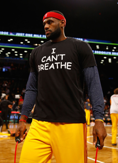 """NEW YORK, NY - DECEMBER 08: LeBron James #23 of the Cleveland Cavaliers wears an """"I Can't Breathe"""" shirt during warmups before his game against the Brooklyn Nets during their game at the Barclays Center on December 8, 2014 in New York City. NOTE TO USER: User expressly acknowledges and agrees that, by downloading and or using this photograph, User is consenting to the terms and conditions of the Getty Images License Agreement. (Photo by Al Bello/Getty Images)"""