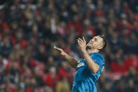 Zenit's Artem Dzyuba gestures during the Champions League group G soccer match between Benfica and Zenit St. Petersburg at the Luz stadium in Lisbon, Tuesday, Dec. 10, 2019. (AP Photo/Armando Franca)