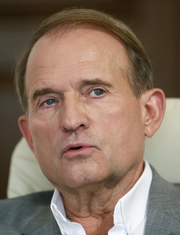 FILE-In this photo taken on Friday, July 12, 2019 a party led by one of Russian President Vladimir Putin's closest associates, tycoon Viktor Medvedchuk, talks during an interview with The Associated Press in Kyiv, Ukraine. Ukraine's Prosecutor General on Tuesday, May 11, 2021, has charged Medvedchuk with high treason, dealing a blow to Kremlin's lobby in Ukraine. (AP Photo/Efrem Lukatsky)
