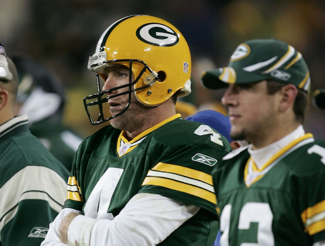 Brett Favre and Aaron Rodgers in their Green Bay days. (Getty)