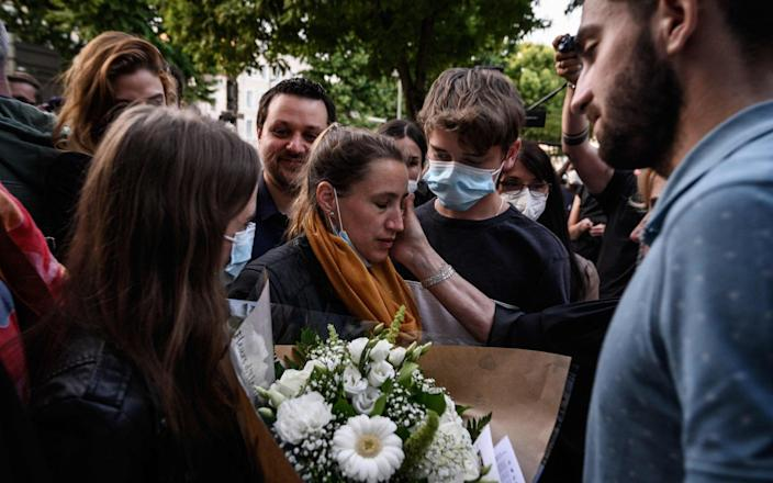 Valerie Bacot leaves Chalon-sur-Saone Courthouse, flanked by relatives and lawyers - AFP/AFP