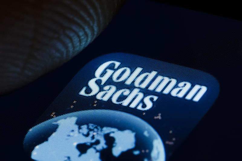 BERLIN, GERMANY - JANUARY 02: In this photo illustration the logo of American multinational investment bank and financial services company The Goldman Sachs Group, Inc. is displayed on a smartphone on January 02, 2019 in Berlin, Germany. (Photo Illustration by Thomas Trutschel/Photothek via Getty Images)