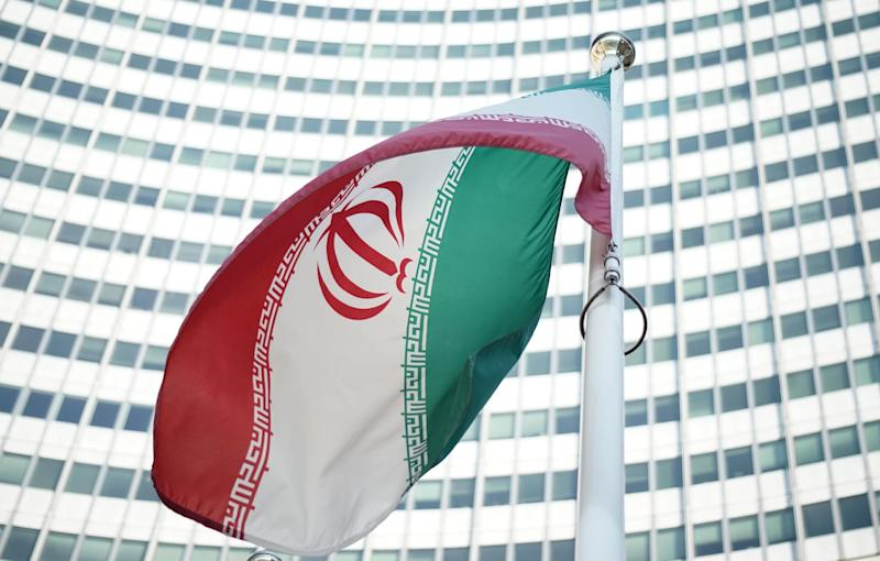 An Iranian flag outside the Vienna International Centre hosting the United Nations (UN) headquarters and the International Atomic Energy Agency (IAEA) in Vienna, on July 3, 2014