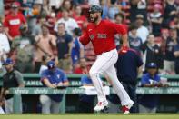 Boston Red Sox's Travis Shaw runs home on his walkoff grand slam during the 11th inning of a baseball game against the Texas Rangers, Monday, Aug. 23, 2021, in Boston. (AP Photo/Michael Dwyer)