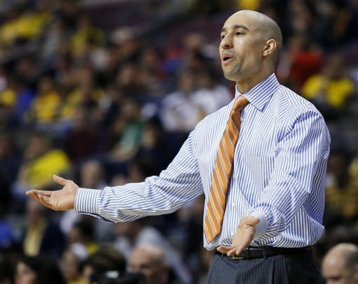 Virginia Commonwealth coach Shaka Smart reacts to a play in the first half against Akron in a second-round game of the NCAA men's college basketball tournament Thursday, March 21, 2013, in Auburn Hills, Mich. (AP Photo/Duane Burleson)