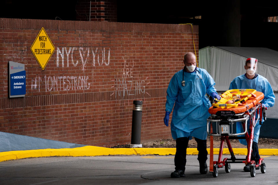A gurney is returned to an ambulance outside the emergency entrance at Montefiore Medical Center in the Bronx, April 20, 2020. (Erin Schaff/The New York Times)