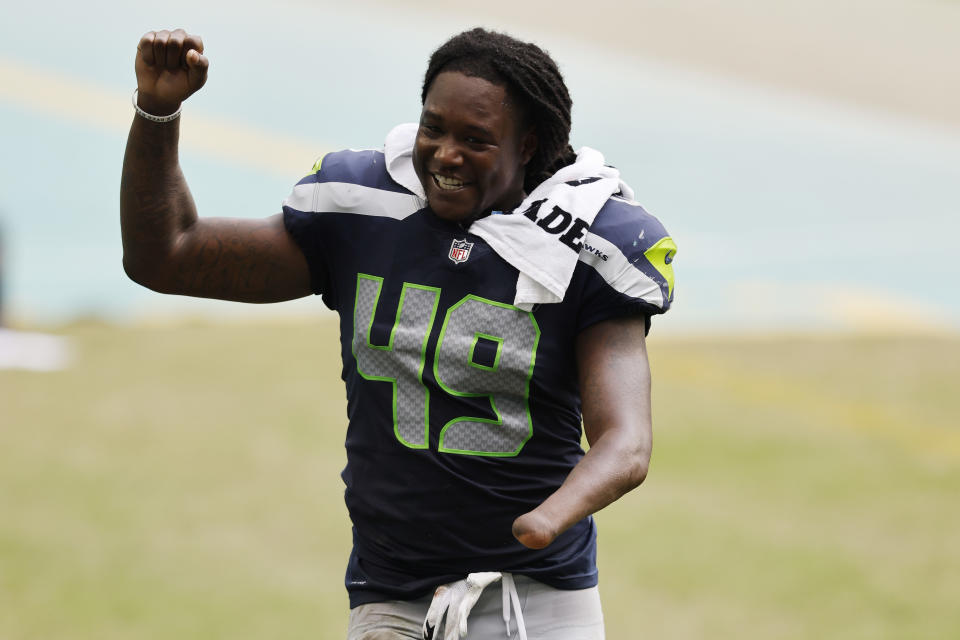 Shaquem Griffin celebrated a win over the Miami Dolphins in 2020, but now he's joining them. (Photo by Michael Reaves/Getty Images)