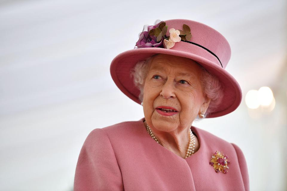 <p>AFP via Getty Images</p> (The Queen spoke to General Sir Mark Carleton-Smith on Tuesday morning)