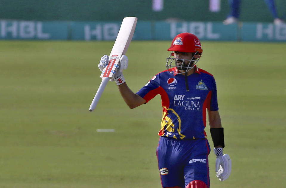 Karachi Kings' Babar Azam raises bat to celebrates after scoring fifty during a Pakistan Super League T20 cricket match between Karachi Kings and Multan Sultans at the National Stadium, in Karachi, Pakistan, Saturday, Feb. 27, 2021. (AP Photo/Fareed Khan)