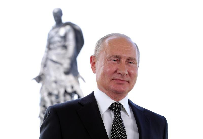 President Vladimir Putin appears in a televised address to the nation in Khoroshevo, the Tver region, with a monument to World War II Red Army soldiers seen in the background, Russia, Tuesday, June 30, 2020. Putin urged voters to cast ballots in a constitutional vote wrapping up Wednesday that could allow him to extend his rule until 2036. (Mikhail Klimentyev, Sputnik, Kremlin Pool Photo via AP)