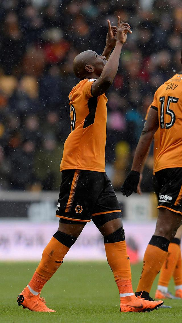 "Soccer Football - Championship - Wolverhampton Wanderers vs Burton Albion - Molineux Stadium, Wolverhampton, Britain - March 17, 2018 Wolves' Benik Afobe celebrates scoring their second goal Action Images/Alan Walter EDITORIAL USE ONLY. No use with unauthorized audio, video, data, fixture lists, club/league logos or ""live"" services. Online in-match use limited to 75 images, no video emulation. No use in betting, games or single club/league/player publications. Please contact your account representative for further details."