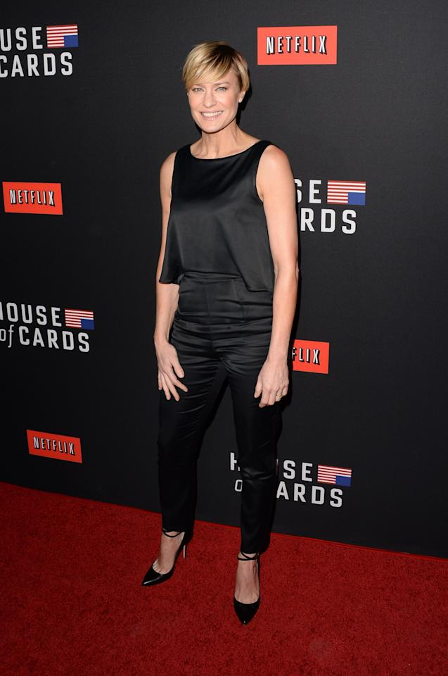 "LOS ANGELES, CA - FEBRUARY 13: Actress Robin Wright arrives at the special screening of Netflix's ""House of Cards"" Season 2 at the Directors Guild of America on February 13, 2014 in Los Angeles, California. (Photo by Jason Merritt/Getty Images)"