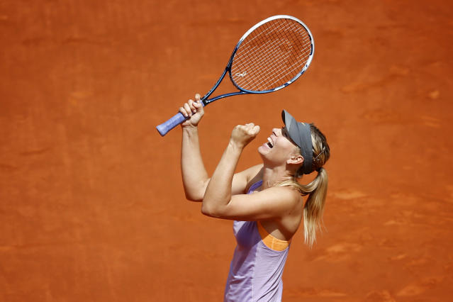 Maria Sharapova from Russia reacts after defeating Agnieszka Radwanska from Poland during a Madrid Open tennis tournament match in Madrid, Spain, Saturday, May 10, 2014 . (AP Photo/Daniel Ochoa de Olza)