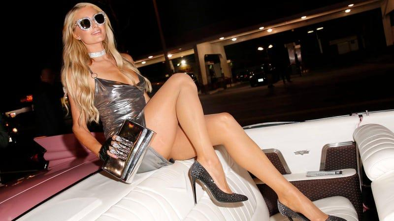 Paris Hilton in a mini dress and heels showing her sexy legs