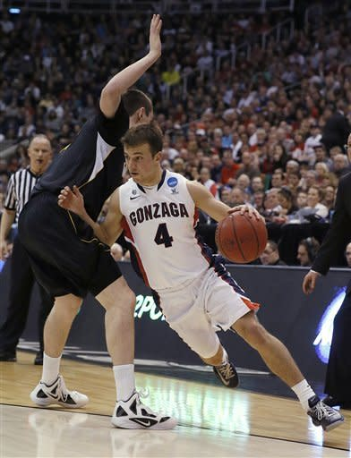 Gonzaga's Kevin Hangos, right, drives past Wichita State's Jake White in the first half during a third-round game in the NCAA men's college basketball tournament in Salt Lake City on Saturday, March 23, 2013. (AP Photo/George Frey)