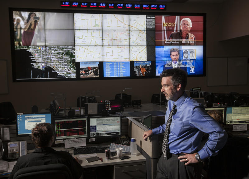 """In this photo taken Friday, June 29, 2012, Jeff Brantingham, anthropology professor at the University of California Los Angeles, displays a computer generated """"predictive policing,"""" zones at the Los Angeles Police Department Unified Command Post (UCP) in Los Angeles. Police officials say they are having success with a computer algorithm model that helps determine where to send officers to prevent or possibily interrupt a crime, which may serve as a model for other cash-strapped law enforcement agencies. (AP Photo/Damian Dovarganes)"""