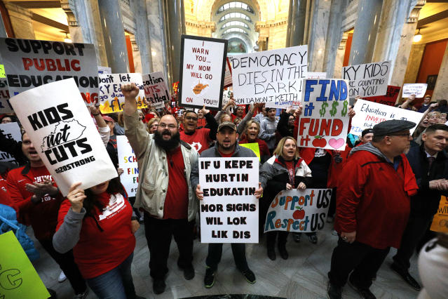 <p>Public school teachers and their supporters protest against a pension reform bill outside the senate chambers at the Kentucky State Capitol, April 2, 2018 in Frankfort, Ky. (Photo: Bill Pugliano/Getty Images) </p>