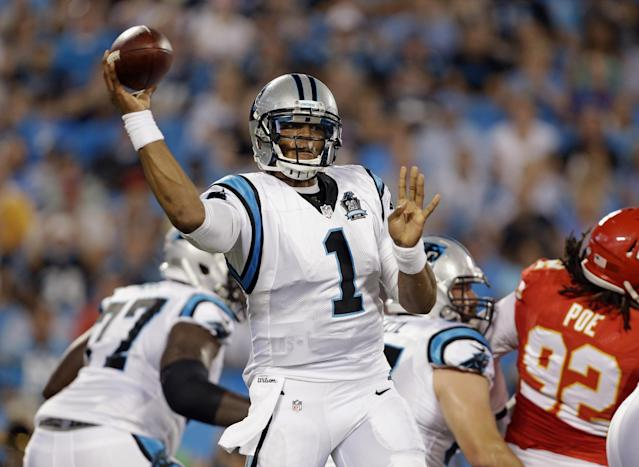 Carolina Panthers' Cam Newton (1) throws a pass against the Kansas City Chiefs during the first half of an NFL preseason football game in Charlotte, N.C., Sunday, Aug. 17, 2014. (AP Photo/Bob Leverone)