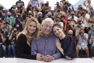 Virginie Efira, from left, director Paul Verhoeven, and Daphne Patakia pose for photographers at the photo call for the film 'Benedetta' at the 74th international film festival, Cannes, southern France, Saturday, July 10, 2021. (AP Photo/Brynn Anderson)