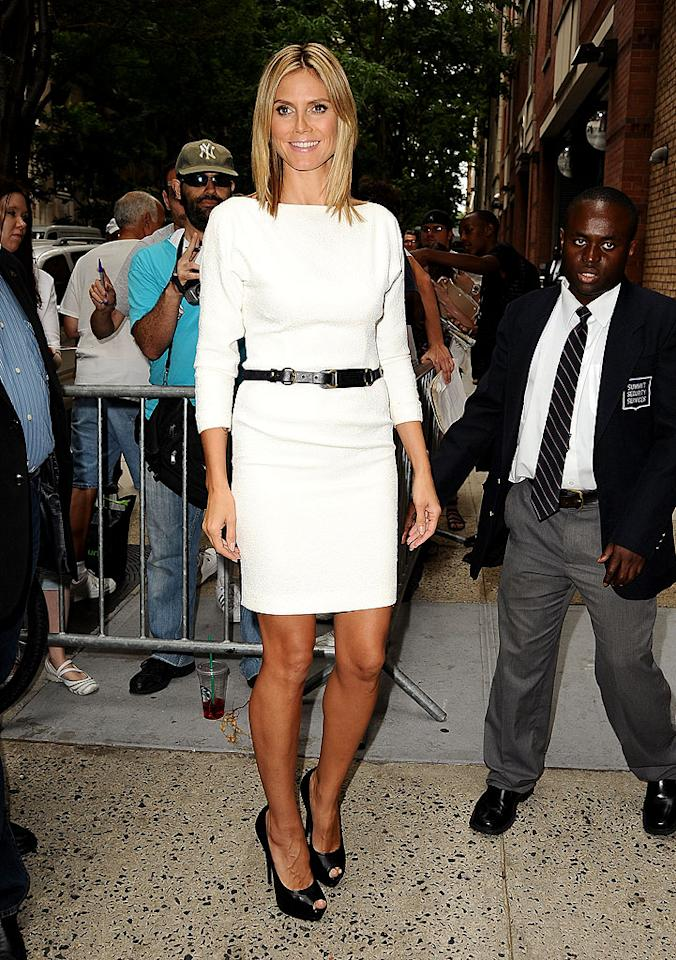 """Also looking glam while out and about in the Big Apple was """"Project Runway"""" hostess with the mostest, Heidi Klum, who turned heads in this belted cream dream and sky-high peep-toes. (7/19/2012)<br><br><a target=""""_blank"""" href=""""http://tv.yahoo.com/news/klum-reflects-project-runway-early-struggles-215015322.html"""">Klum reflects on """"Runway's"""" early struggles</a>"""