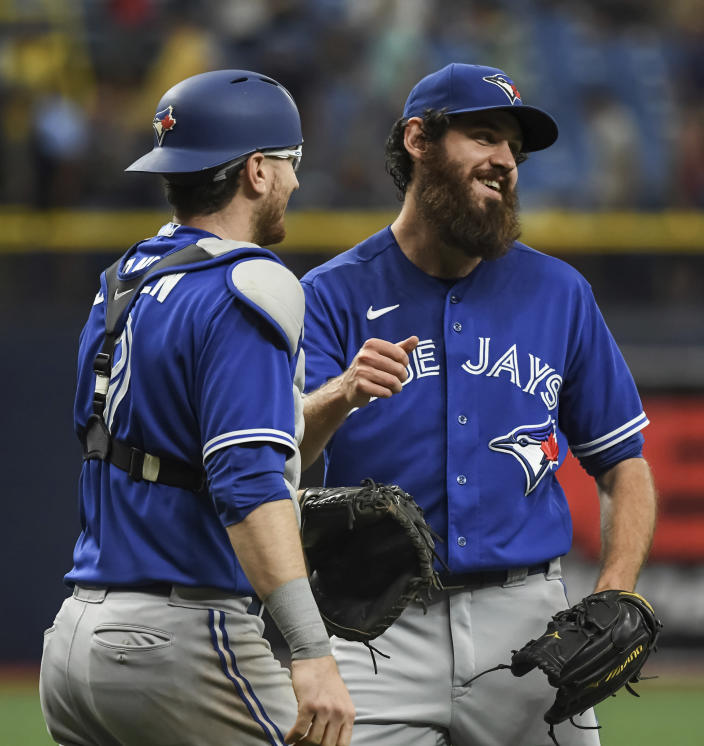 Toronto Blue Jays catcher Danny Jansen, left, and closer Jordan Romano celebrate a win over the Tampa Bay Rays in a baseball game Sunday, July 11, 2021, in St. Petersburg, Fla.(AP Photo/Steve Nesius)