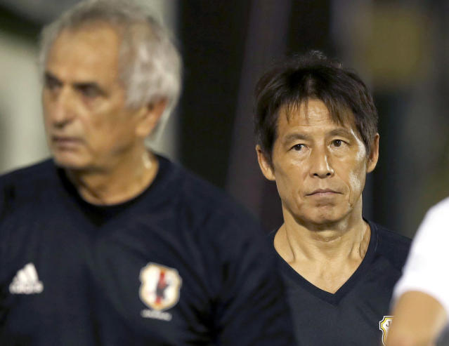 In this Aug. 28, 2017, photo, then Japan Football Association (JFA) technical director Akira Nishino, right, watches Japan national team's practice with then Japan's coach Vahid Halilhodzic, left, before a soccer match against Australia in Saitama, near Tokyo. JFA President Kozo Tashima said on Monday, April 9, 2018, Japan fired Halilhodzic two months before soccer's World Cup in Russia and replaced him immediately with Nishino. (Fumine Tsutabayashi/Kyodo News via AP)