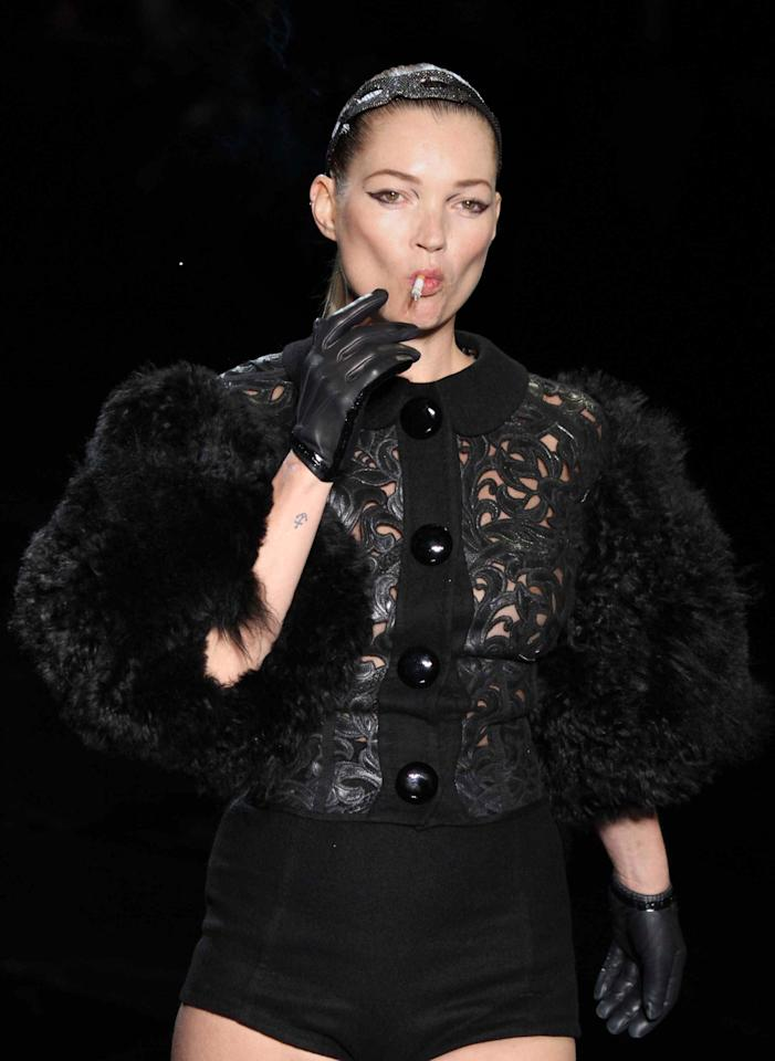 <p>The image of Kate Moss smoking during the finale of Marc Jacobs' AW11 Louis Vuitton show will forever be ingrained in our minds. Causing countless fire hazards, the British rebel didn't have a care in the world. What's even more ironic is that the show was held on National No Smoking Day.<br /><i>[Photo: Getty]</i> </p>