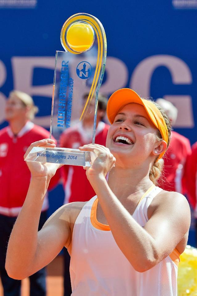 Canadian Eugenie Bouchard hold the trophy after defeating Czech Karolina Pliskova at the WTA final in Nuremberg, Germany, Saturday, May 24, 2014. Bouchard won 6-2, 4-6, 6-3. (AP Photo/dpa, Daniel Karmann)