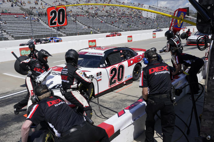 Harrison Burton (20) gets service in the pits during of the rain delayed NASCAR Xfinity Series auto race at Martinsville Speedway in Martinsville, Va., Sunday, April 11, 2021. (AP Photo/Steve Helber)