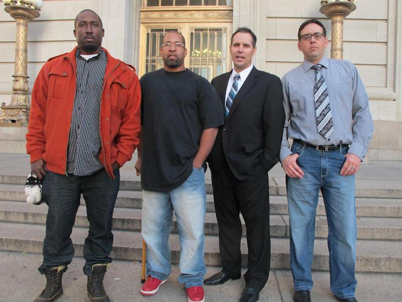 From left to right, Damon Robinson, 36, of Lexington, Ky., Mark Hedges, 45, of Cincinnati., Jim Lancaster, 46, of Alexandria, Ky., and Micah Morthland, 38, of Highland Heights, Ky., pose in front of the Hamilton County Court of Common Pleas, Monday, Nov. 5, 2012, in Cincinnati, shortly after filing a lawsuit against builders of Cincinnati's first and only casino, slated to open in the spring. The men were injured while pouring concrete on a second floor at the casino in January and allege that the construction firms neglected safety to get the project done on time. (AP Photo/Amanda Lee Myers)