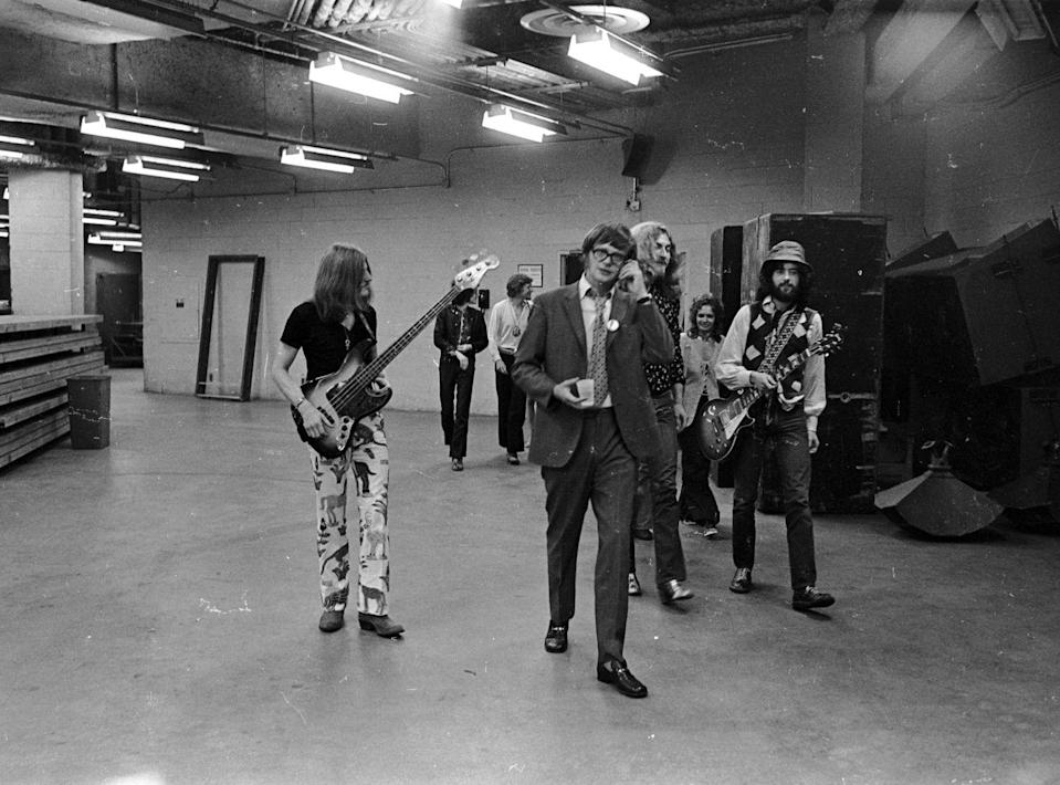 <p>Led Zeppelin's bassist, John Paul Jones, singer, Robert Plant, and guitarist, Jimmy Page, walk backstage at the Forum in Los Angeles in 1977. </p>