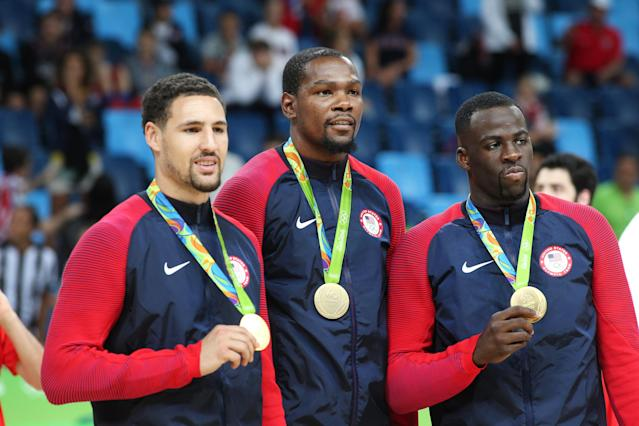 Klay Thompson, Kevin Durant and Draymond Green. (Photo by Tim Clayton/Corbis via Getty Images)