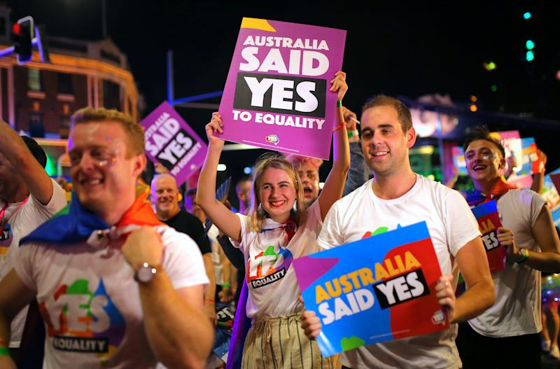 Participants hold banners regarding same-sex marriage during the 40th anniversary of the Sydney Gay and Lesbian Mardi Gras Parade in central Sydney, Australia March 3, 2018. (Steven Saphore / Reuters)