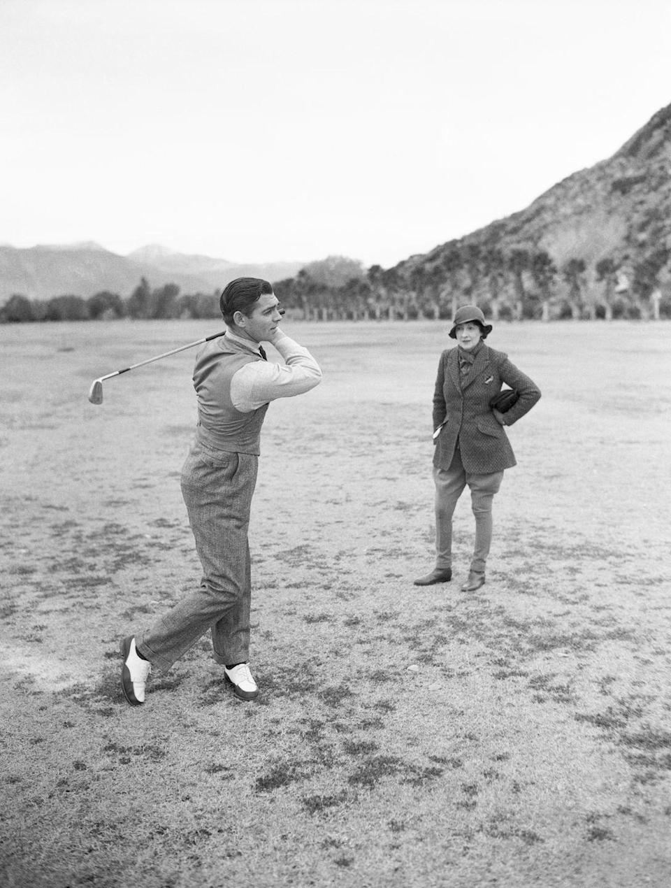 <p>The actor – who later went on to star in <em>Gone with the Wind, </em>one of the highest-grossing films in box office history – practices his golf game on December 19, 1932. Gable was approximately 31-years-old at the time that this picture was taken. </p>