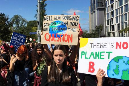 FILE PHOTO: Protesters demanding action on climate change gather in Melbourne, Australia March 15, 2019.  REUTERS/Sonali Paul/File Photo