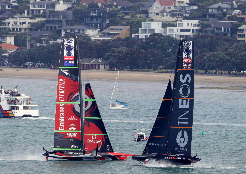 Team New Zealand yacht, left, and Britain's Team UK compete in the America's Cup World Series on the Hauraki Gulf off Auckland, New Zealand, Friday, Dec. 18, 2020. (New Zealand Herald via AP)