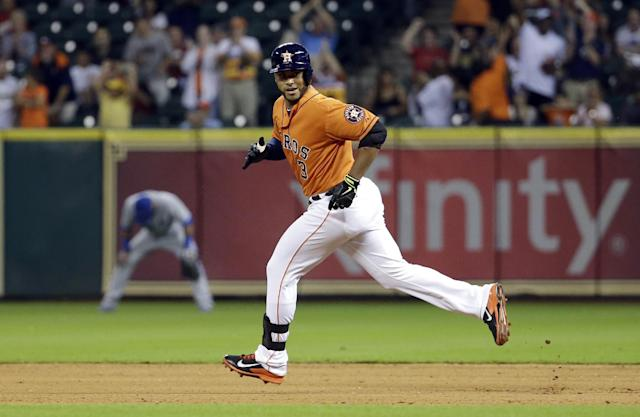 Houston Astros' Gregorio Petit (3) looks back toward the dugout as he runs the bases after hitting a home run against the Toronto Blue Jays during the eighth inning of a baseball game Friday, Aug. 1, 2014, in Houston. (AP Photo/David J. Phillip)