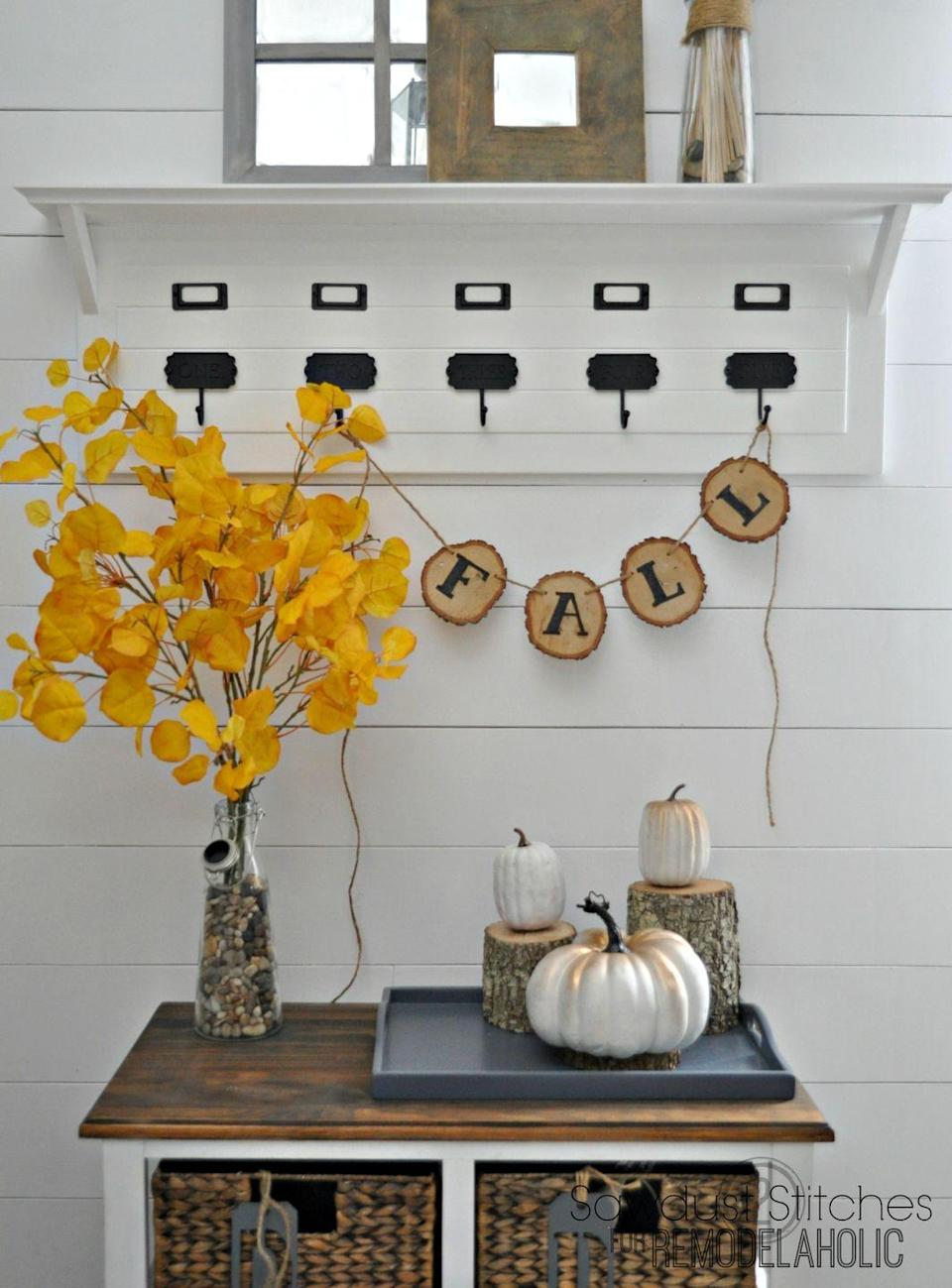 "<p>A simple fall banner can stay up all season without being too specific to just one holiday. <a href=""https://www.remodelaholic.com/rustic-fall-wood-slice-banner/"" rel=""nofollow noopener"" target=""_blank"" data-ylk=""slk:Remodelaholic"" class=""link rapid-noclick-resp"">Remodelaholic</a> used a wood burner to etch the letters onto each wood slice, but vinyl transfer paper would work just fine.</p><p><a class=""link rapid-noclick-resp"" href=""https://loveleovinyl.com/shop/ols/products/ultra-glitter-adhesive"" rel=""nofollow noopener"" target=""_blank"" data-ylk=""slk:BUY NOW"">BUY NOW</a><em><strong> Glitter adhesive paper, $2.50</strong></em></p>"