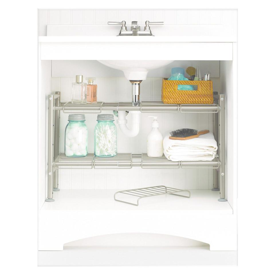"<p><strong>88 Main</strong></p><p>target.com</p><p><strong>$24.99</strong></p><p><a rel=""nofollow"" href=""https://www.target.com/p/expandable-under-sink-storage-rack-champagne-88-main/-/A-50281513"">BUY NOW</a></p><p>Pipes in your under-sink cabinet can really get in the way of most organizing boxes, but this storage unit has removable shelf pieces so you can arrange them <em>around</em> pipes, maximizing the space you do have.</p>"