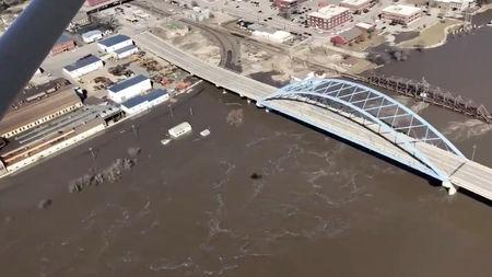 The Kansas side of the Missouri River is seen in Atchison, Kansas, U.S., March 22, 2019 in this still image taken from a video obtained from social media. SHAWN RIZZA/via REUTERS