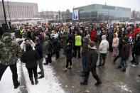A group of people attend a protest against the Finnish government's regulations to fight the coronavirus pandemic in Helsinki, Saturday, March 20, 2021. Some 400 protesters gathered peacefully in downtown Helsinki. (Antti Aimo-Koivisto/Lehtikuva via AP)