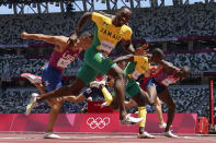 Hansle Parchment, of Jamaica, wins the men's 110-meter hurdles final past Grant Holloway, of the United States, at the 2020 Summer Olympics, Thursday, Aug. 5, 2021, in Tokyo, Japan. (AP Photo/David J. Phillip)