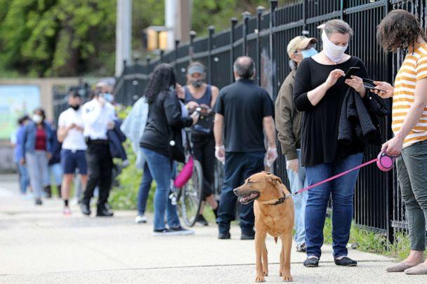 PHOTO: People stand in line for to receive a free COVID-19 test on May 4, 2020 in Jersey City, N.J. (Kevin Wexler/NorthJersey.com via USA Today Network)