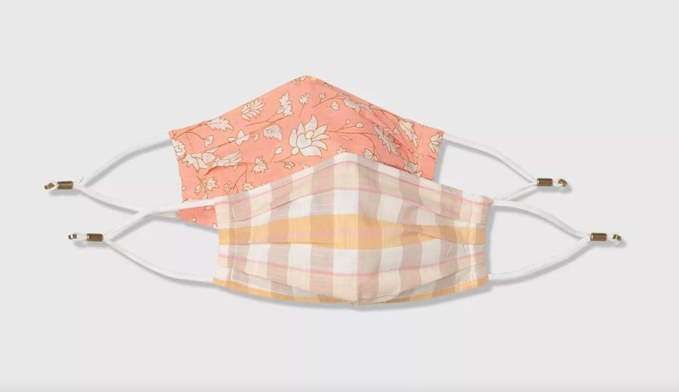 <p>Brighten up your day with the cute and coral<span>Universal Thread Women's 2pk Fabric Face Mask</span> ($5). It's made from 100 percent breathable cotton and has a pocket for a filter. It has a nose wire and adjustable ear loops to to secure the mask in place.</p>